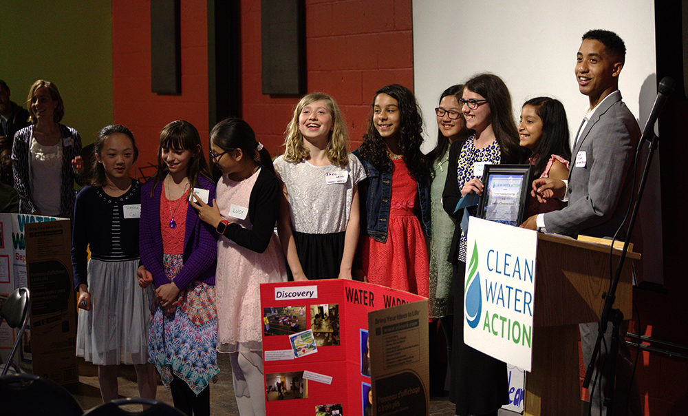 "The ""Water Warriors"" receiving the Leaders of Tomorrow award at the 2018 GLAC"