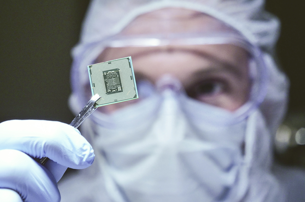 Lab worker holding a microchip