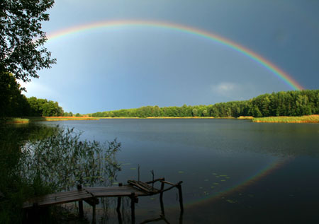 Rainbow over a lake. Photo credit: Viaceslav / Shutterstock