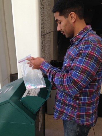 A person properly disposing of medications at a drug disposal drop box
