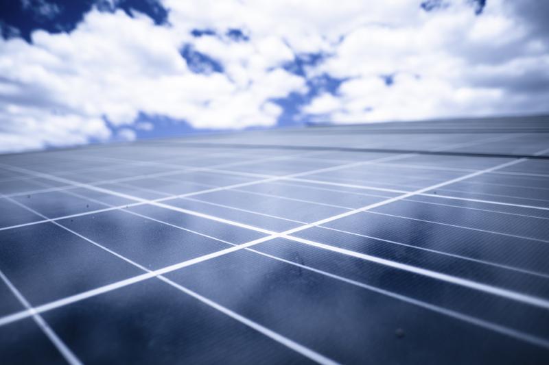 Solar panels, blue sky. Photo credit: epicurean / iStock