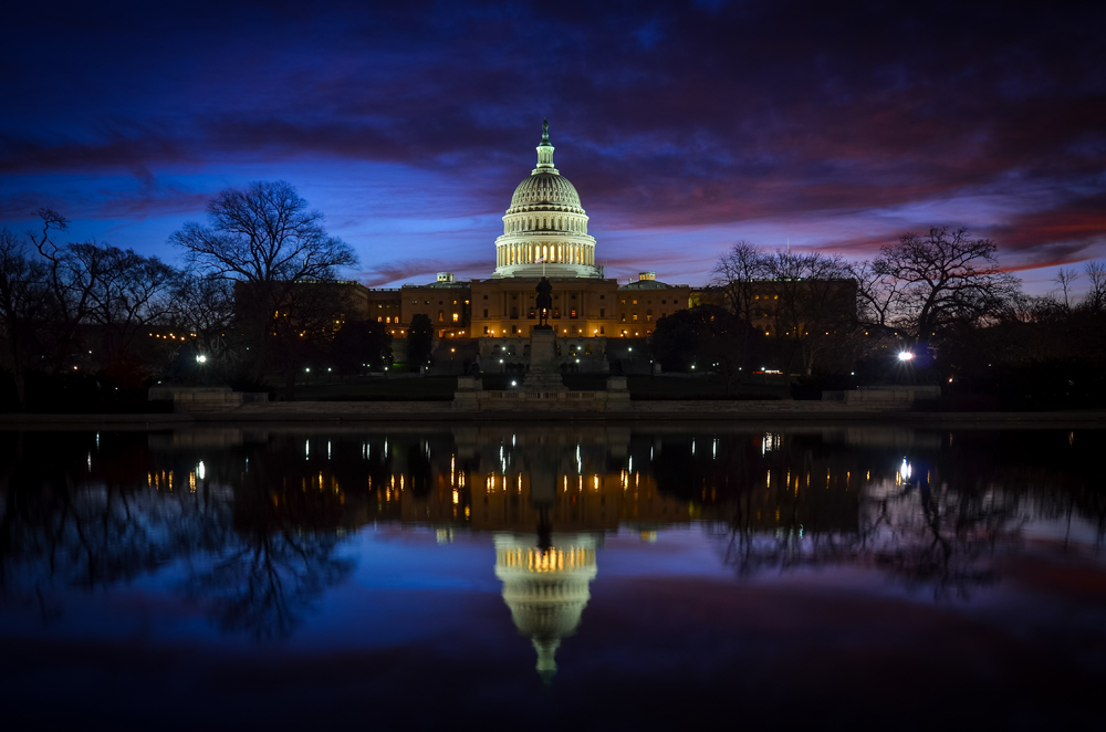 Capitol building reflected at night. Photo credit: Orhan Cam / Shutterstock