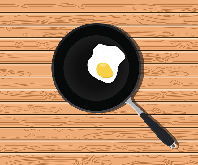 nonstick pan with an egg in it