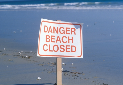 """Beach closed"" sign."