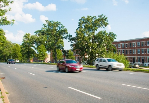 Cars driving on an arterial road near Druid Hill Park in Baltimore