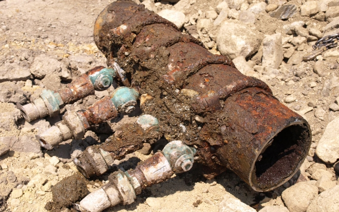 corroded pipe with lead service fittings