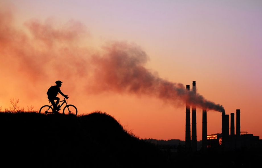 Sunset, powerplant, cyclist. Photo credit: Kalmatsuy / Shutterstock