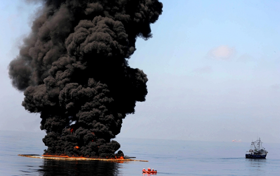 An offshore drilling rig on fire.
