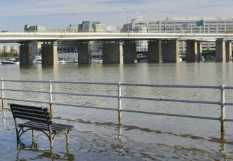 Flooding along the Anacostia in DC - a partially submerged park bench. Photo credit: JuneJ / Shutterstock