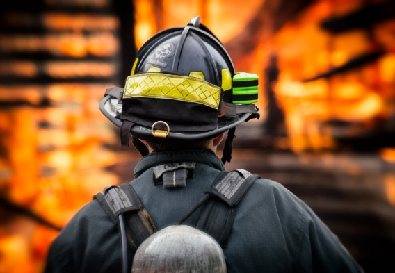 Fire Fighter in front of a burning building. Credit: Mike Gabelmann / Creative Commons - Flickr