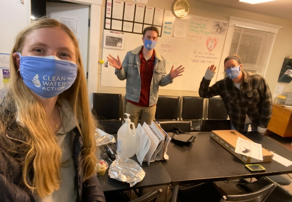 Picture of canvassers waving with Clean Water Action masks