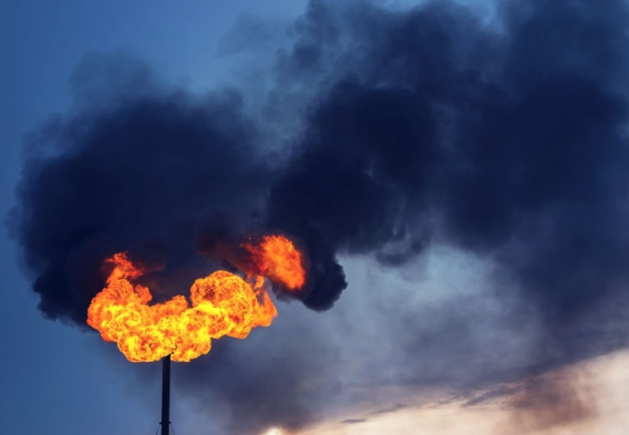 Methane flare, black smoke. Photo credit: Leonid Ikan / Shutterstock