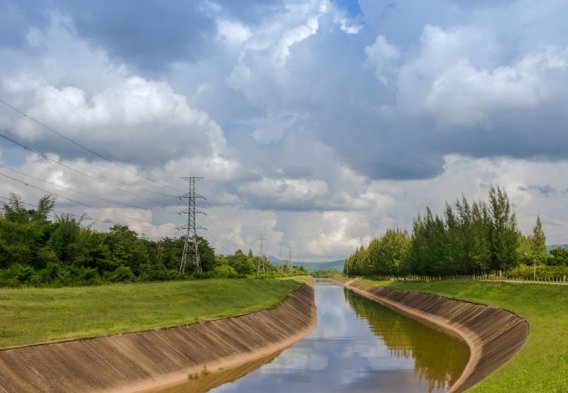 Manmade canal on a sunny day. Photo credit: nayneung1 / Shutterstock